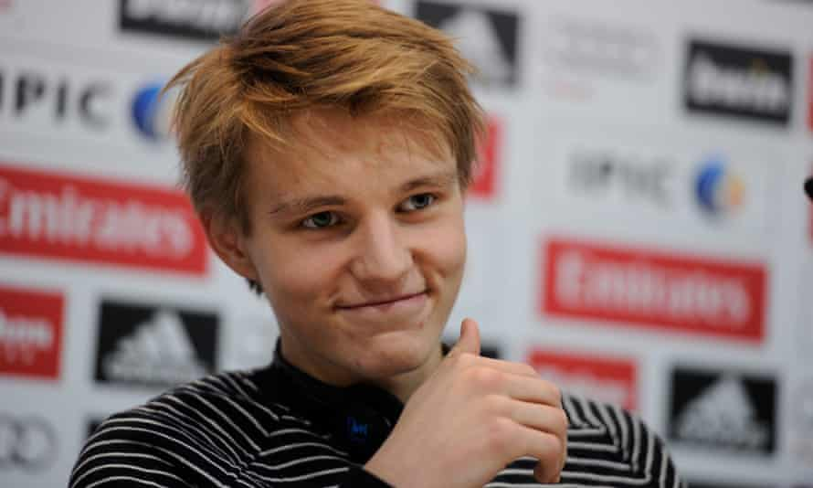 Martin Odegaard is all smiles for the media during his Real Madrid unveiling.
