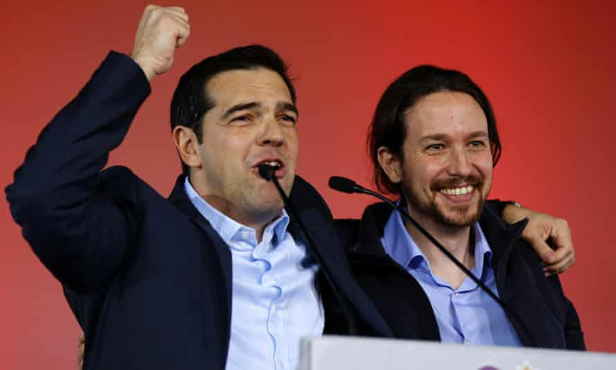 Syriza leader Alexis Tsipras (L) addresses party supporters with Spanish Podemos party chief Pablo Iglesias at the Athens rally.