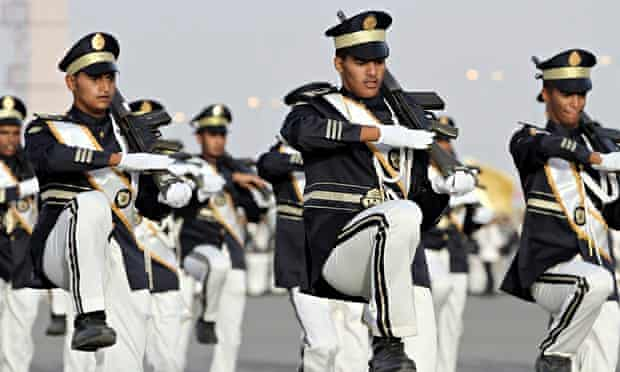Members of the Saudi police force march during their graduation ceremony in Mecca