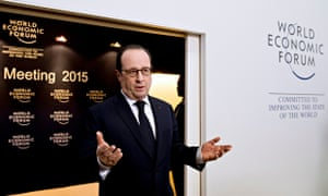 Francois Hollande speaks to the media as he arrives at the World Economic Forum in Davos.