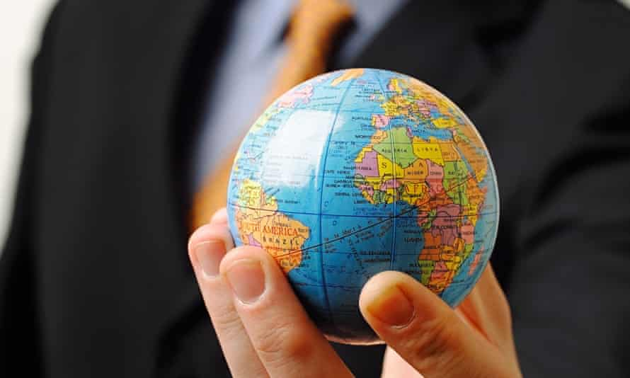 Businessman holding a globe in his hand