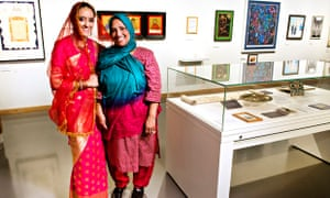 Tahnia Ahmed, left, models the wedding sari of her mother Hasna Hena at the Jewish Museum