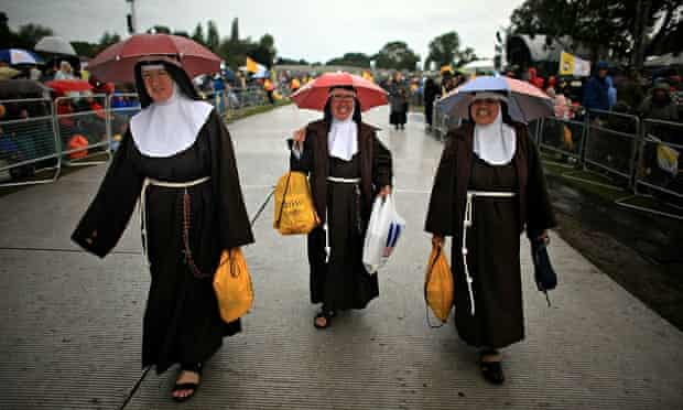 nuns in the rain with umbrellas