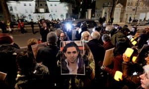 Protesters at a vigil for Raif Badawi outside the Saudi embassy in London