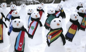 Snowmen decked out in various country flag scarfs, in Davos, Switzerland during the World Economic Forum on 23 Jan 2015.