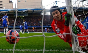Goalkeeper Petr Cech of Chelsea looks on after being beaten by the shot from Jonathan Stead of Bradford City during their FA Cup fourth-round tie at Stamford Bridge.