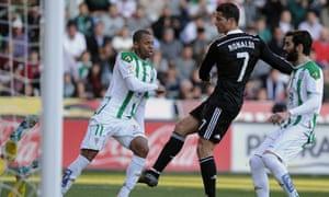 Real Madrid's Cristiano Ronaldo kicks the leg of Cordoba defender Edimar Fraga and earns himself a red card.