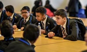 Students relax in the canteen at St Alban's academy in Birmingham