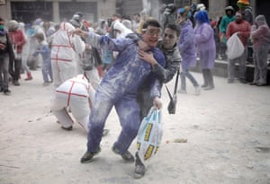 Victors and casualties mixing among the flour fight.