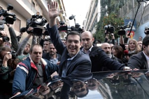 Alexis Tsipras, leader of the Syriza party, is all smiles as he greets supporters after casting his vote.