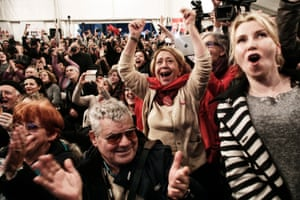 Syriza supporters cheer at exit poll results which indicate that their party have a clear lead.