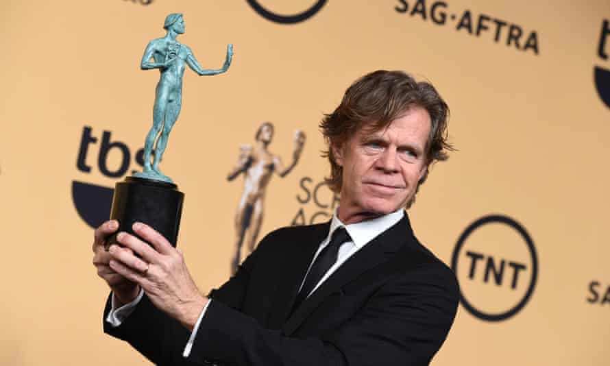 William H. Macy poses in the press room with the award for outstanding male actor.