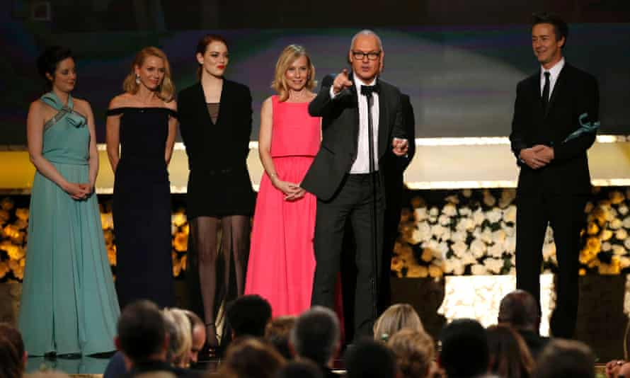 Michael Keaton, from Birdman, accepts the award for Outstanding Performance by a Cast in a Motion Picture at the 21st annual Screen Actors Guild Awards in Los Angeles.