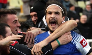 Cesena's Alejandro Rodriguez celebrates with his team-mates after scoring the winning goal.