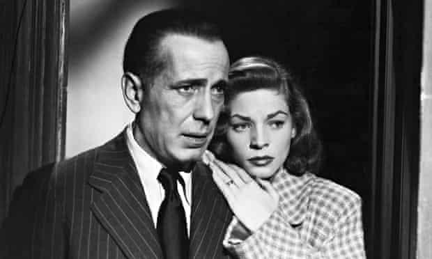 Humphrey Bogart as Philip Marlowe with Lauren Bacall in The Big Sleep.