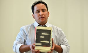 Yahdih Ould Slahi, the younger brother of Guantánamo Diary author Mohamedou, poses with a copy of the book during an event in London.