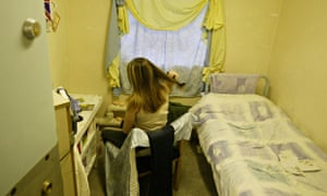 A female prisoner in her cell at a women's prison in the UK