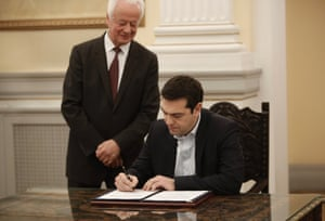 Greek radical leftist party SYRIZA leader Alexis Tsipras (R) signs protocols after his swearing-in as Prime Minister by the President of Republic Karolos Papoulias (unseen) at the Presidential Palace in Athens, Greece, 26 January 2015.