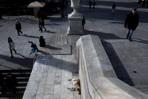 People walk outside a metro station at Syntagma Square in Athens.