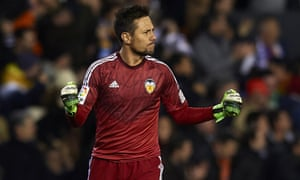 Valencia's Diego Alves celebrates after yet another penalty stop in a heated game against Sevilla in La Liga.