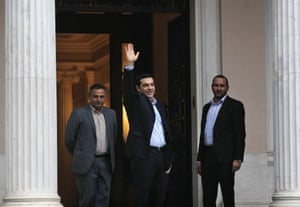 Greek radical left SYRIZA leader and newly sworn-in Greek Prime Minister Alexis Tsipras (C) waves to spectators and media as is on his way to enter the Prime Minister's offices, the Maximos Mansion, in Athens, Greece, 26 January 2015.