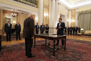 Greek radical leftist party SYRIZA leader Alexis Tsipras (R) is sworn-in as Prime Minister in the presence of Greek President Karolos Papoulias (L) at the Presidential Palace in Athens, Greece, 26 January 2015.