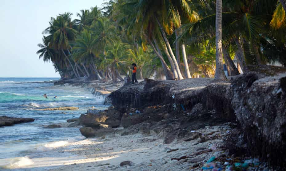 A girl walks at a beach damaged by erosion at Fuvahmulah December 9, 2009.The largest-ever climate talks formally opened on Monday in Denmark aiming to agree the outlines of global deal to stave off dangerous climate change, such as rising seas and more intense storms.