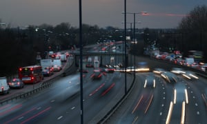 The sun sets as heavy traffic travels on the A40 dual carriageway on the eve of the Easter Bank Holiday weekend on March 28, 2013 in London, UK.