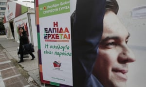 A banner with a picture of Alexis Tsipras, head of Greece's Syriza leftwing main opposition party, decorates the party's campaign kiosk in central Athens, Tuesday, Jan. 20, 2015. The main sign reads in Greek: 'Greens, (referring to the Green party) support Syriza,' and 'Hope is coming'.