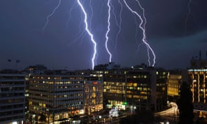 Lightning strikes over buildings at central Syntagma square during heavy rainfall in Athens.