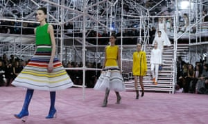 Models present creations by Belgian designer Raf Simons as part of his haute couture spring summer 2015 fashion show.