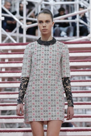 A model presents a creation by Belgian designer Raf Simons as part of his haute couture spring summer 2015 fashion show.