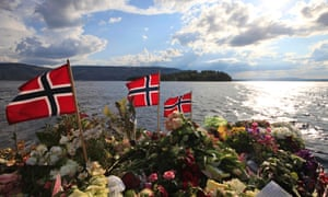 Norwegian flags offer a memorial to the mass killings on Utoya island in 2011.
