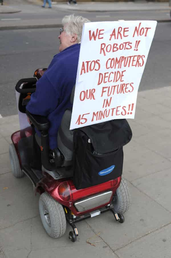 Disabled woman protesting against Atos assessments
