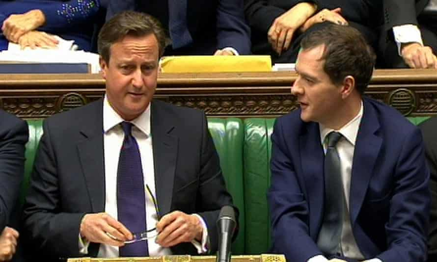 George Osborne (r) speaks to David Cameron during Prime Minister's Questions in the House of Commons, London
