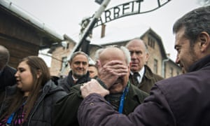 Survivor Mordechai Ronen is comforted by his son as he arrives at Auschwitz on Monday.