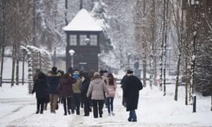Visitors walk around the former Auschwitz camp on Monday.