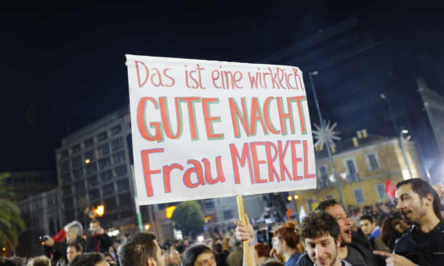 Poster reads 'That's a really good night Frau Merkel', in a sign of how many feel about 'paymaster' Germany.