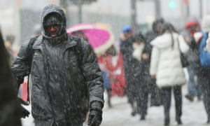 People walk along a Manhattan street in heavy snow on January 26, 2015 in New York City.