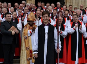 Libby Lane (front) is applauded by other clergymen in front of York Minster.