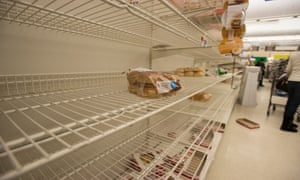 Empty bread shelves at the Stop and Shop at South Bay in Boston on Monday.