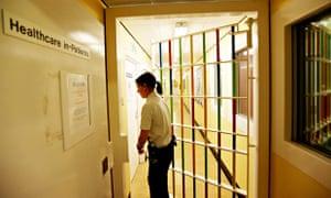 prison guard locks a door