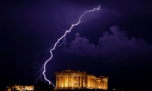 A flash of lightning illuminates the sky over  the Parthenon temple in Athens