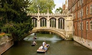 Punts drift under the Bridge of Sighs at St John's College, Cambridge.