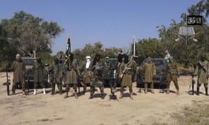 Boko Haram leader Abubakar Shekau (centre) appears in a video distributed by the militant group.