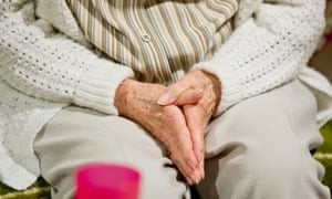 An elderly dementia patient rests her hands in her lap at the Fritz-Rupprecht-Heim, home for the elderly, in Fuerth, Germany, 13 September 2013.