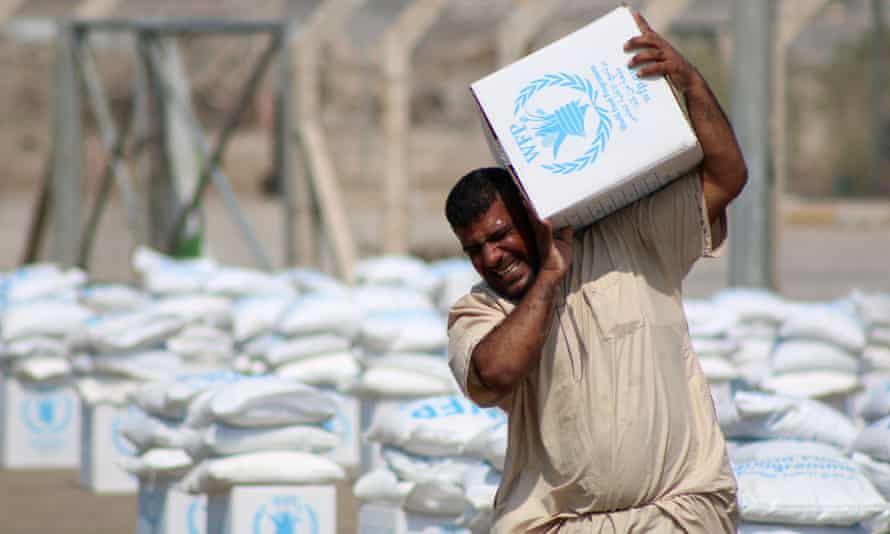 An Iraqi collects a food parcel distributed by the World Food Programme, which is assisting 50,000 displaced families in southern Iraq.