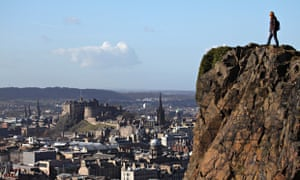 A walker on Arthur's Seat looks towards Edinburgh Castle.