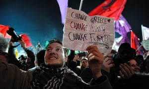 Syriza supporters celebrated the party's victory in the Greek parliamentary elections in front of the University of Athens.