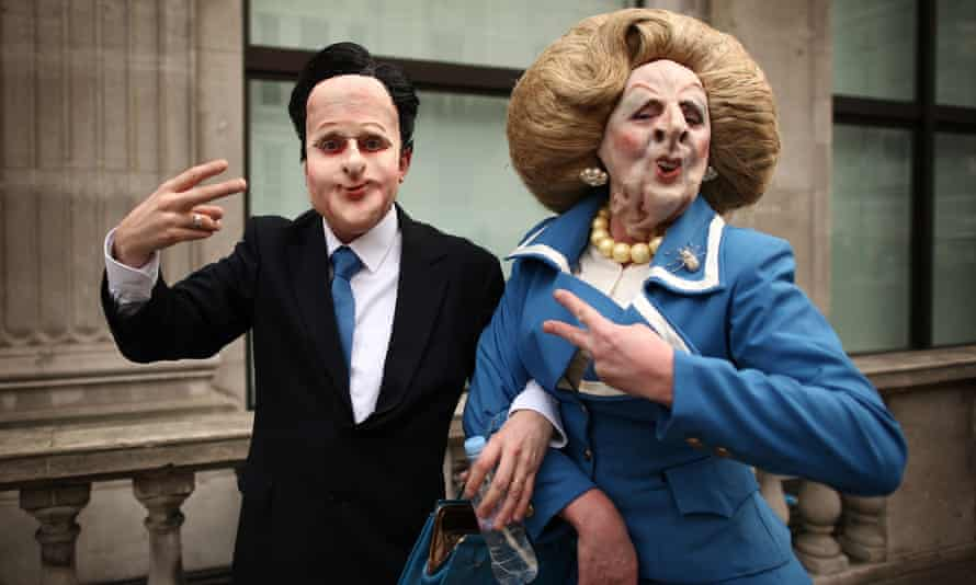 Protesters dressed as  David Cameron and Margaret Thatcher
